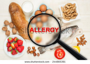 stock-photo-allergy-food-concept-food-on-wooden-table-244665391